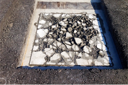 写真-4 RC床版上面の状態の再現例(砂利化)
